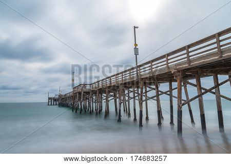 Beach Dreamin'      Long exposures of the structural supports of a pier overlooking the pacific ocean
