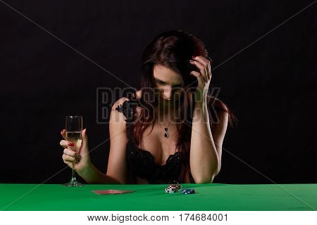pretty young woman gambling on green table