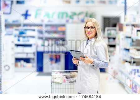 Pharmacy Professional Scientist Using Tablet In Pharmaceutical Field. Medical Details With Blonde Ph