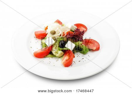 Greek Salad Plate with Tomato, Cucumber, Onion and Olives. Isolated on White Background
