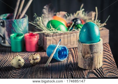 Preparing Eggs For Easter With Hay And Feathers