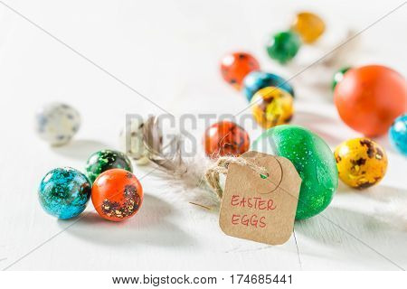 Closeup Of Various Easter Eggs On White Table