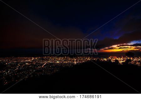 Tantalus Lookout at night, Puu Ualakaa State Park Honolulu. Tourists on panoramic city, Waikiki Beach and Diamond Head. Waikiki skyline Oahu Hawaii, United States. Vacation and nightlife concept. poster