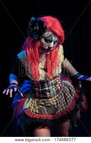 Theatrical lighting, special effects, and a custom makeup bring this evil clown to life. This is her circus now