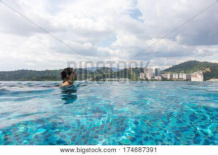 Asian Chinese Girl Ejoying Holiday At Outdoor Swimming Pool