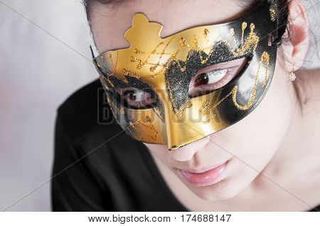 Girl Brunette In A Theatrical Mask Looking Away