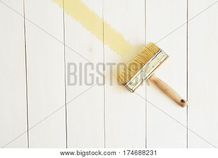 Brush for a painting on a white wooden background