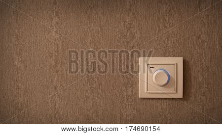 Switch button on the wall. Electrical round light switch on the wall.