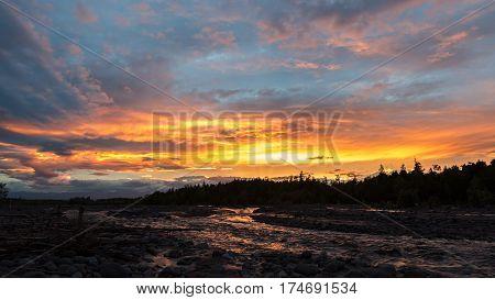 Beautiful sunset on the river Studenaya. Kamchatka Peninsula.