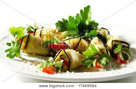 Baked Eggplant Plate Dressed with Parsley and Tomato. Isolated on White Background