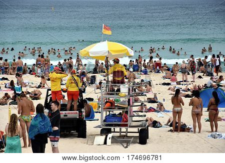 Sydney Australia - Feb 5 2017. People relaxing swimming and sun bathing on Bondi beach. Bondi beach is one of the most famous tourist sites in Australia.