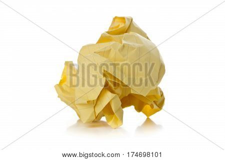 Crumbled yellow paper with linings ball on white background - waste or fail concept