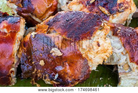 Juicy pork meat cooked on grill. Traditional cuisine of Spain. Sliced pork barbecue with gold skin. Spanish dish lechon close image for restaurant menu or eatery illustration. Tasty meat ready for eat