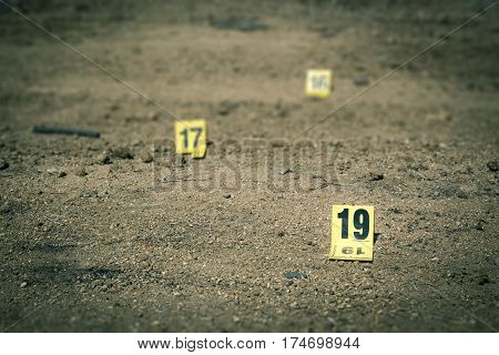 group of evidence marker number in crime scene investigation in cinematic tone