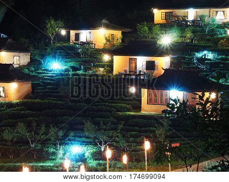 Night view of tea farm and hut at Ban Rak Thai village a Chinese settlement in Mae Hong Son province Northern of Thailand