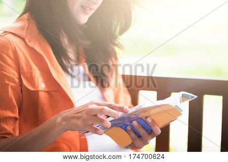 Woman reading a book. Relax reading and education concept.