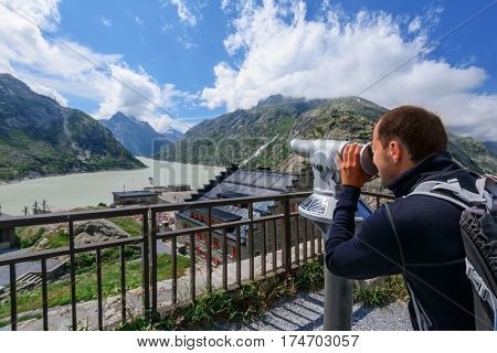 Great view from the top of the Grimsel pass over the Grimselsee hotel and dam. Switzerland, Bernese Alps, Europe.
