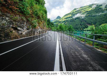 Amazing view of alpine road and lake, Switzerland, Europe.