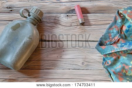 military flask on wooden background. A close up