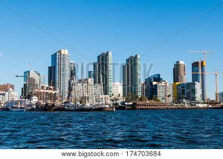 SAN DIEGO, CALIFORNIA - MARCH 2, 2017:  View from the ocean of the downtown city skyline, including the Maritime Museum of San Diego historic vessels.