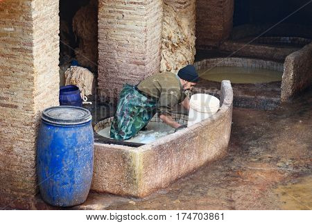 Worker In The Leather Traditional Tannery. Fez, Morocco