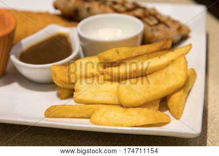Potato Fries On White Plate.