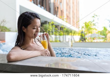 Woman enjoy her drink in swimming pool