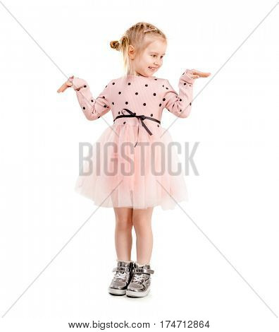 Amazing girl in a funny pose, holding her hands, dressed in pink polkadot clothes, isolated