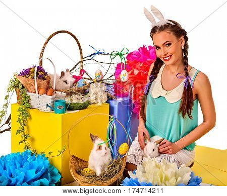 Easter bunny ears headband for women. Girl holding basket bunny and eggs. Woman with holiday hairstyle and make up touch rabbit with flowers. Adults at festival. White background isolated.