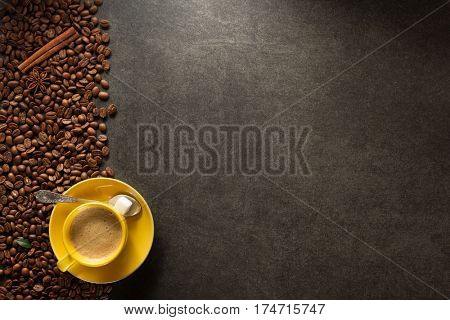 cup of coffee and beans on table background