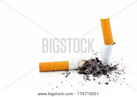 Single cigarette butt with ash isolated on white background