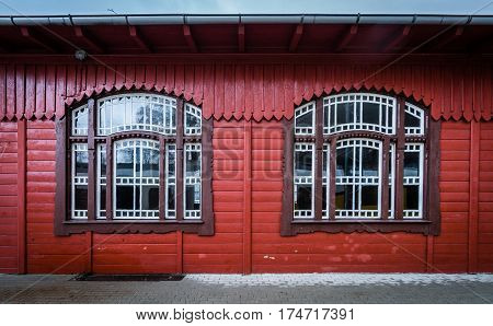 Windows and wooden building facade of the old train station building in Szklarska Poreba, Poland