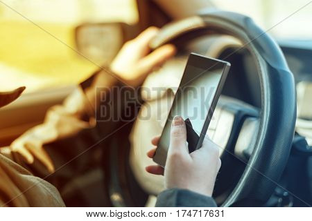 Driving car and using mobile phone to send text message is dangerous behaviour in traffic that could cause accident