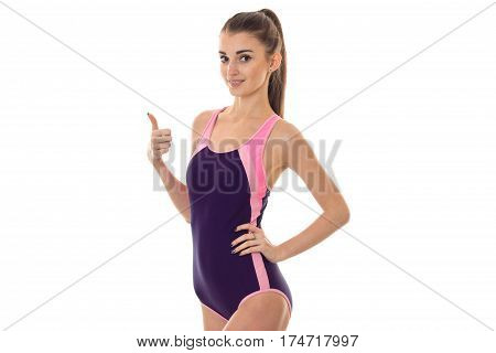 pretty slim brunette sports woman in body swisuit posing isolated on white