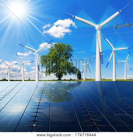 Solar panels with wind turbines (3D illustration) and a power line on a blue sky with clouds and sun rays (photo). Solar and wind energy