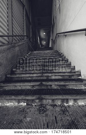 Industrial warehouse concrete staircase black and white monochromatic wide angle lens image