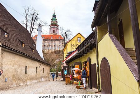 Cesky Krumlov, Czech Republic - February 26, 2017: Famous landmark, castle tower, historic center street view
