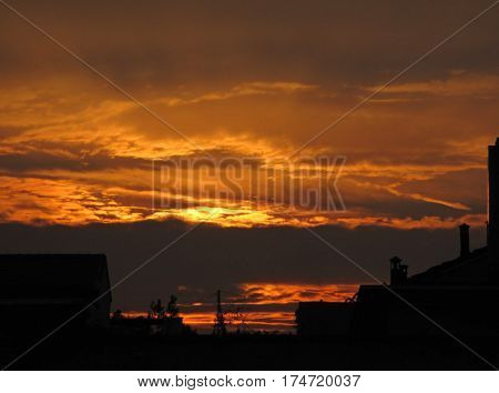 Peaceful orange color gradation of the sky at dawn in Milan, Italy