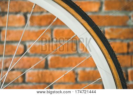 rim of a bicycle wheel with spokes. Creative background interior brick wall.