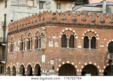 The Domus Mercatorum with crenellations and portico in Verona. Italy