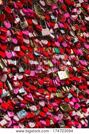 VERONA ITALY - MAY 1 2016: Verona - Lover locks and master key locks closed up at Casa di Giulietta (in front of Juliet's Balcony). People believes this would help blessing in their love lives.