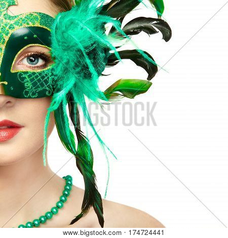 Beautiful young woman in mysterious green Venetian mask. Fashion photo. Holidays and celebrations