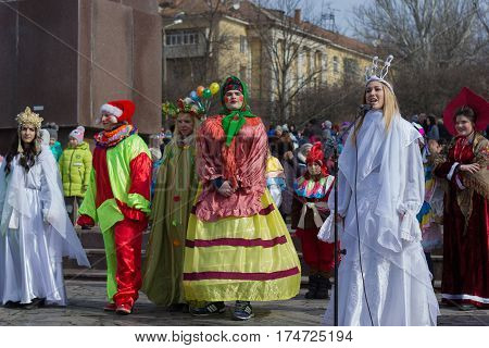 Marganets, Ukraine - Fabuary, 26: Fancily dressed teenage actors perfom while celebrating Slavic family holiday Maslenitsa on 26, Febuary, 2017 in Marganets, Ukraine