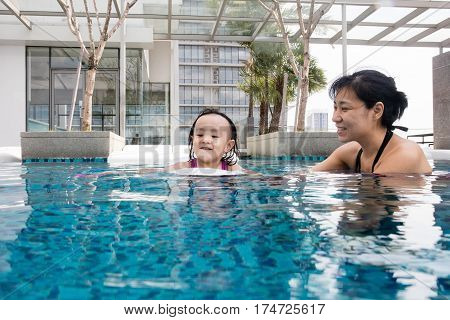 Asian Chinese Mother And Daugther Playing At Swimming Pool