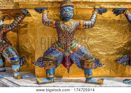 Sculpture of a Thotsakhirithon or giant demon Yaksha at the Emerald Buddha Temple in Bangkok