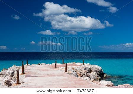 Tropical paradise - pier and blue ocean sunny day and blue sky travel background, Curacao, Netherlands Antilles