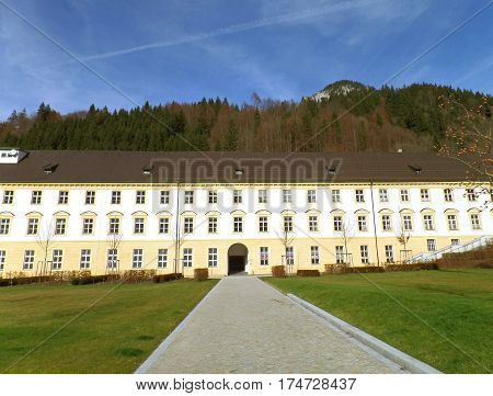 Cobblestone walkway to the Vintage Building of Ettal Abbey in Garmisch-partenkirchen, Bavaria, Germany
