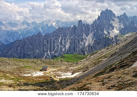 Mountain Valley With Hut In Dolomites, Italy