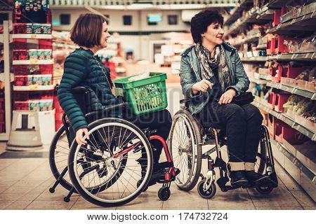 Two disabled woman in a wheelchairs