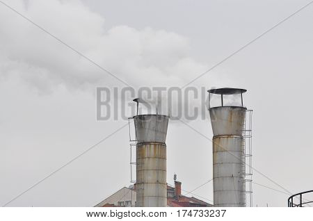 Dirty smoke from smokestack of a industrial factory